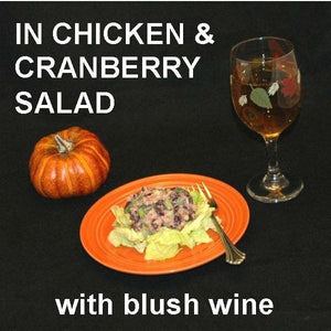 Chicken Salad with Craisins®, green onions and Sweet Ginger Cranberry Dressing, served on bibb lettuce with blush wine Fall