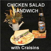 Load image into Gallery viewer, Chicken Salad Sandwich with Craisins®, green onions, Sweet Ginger Cranberry Dressing on sourdough bread, served with fall ale