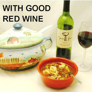 Tortellini Soup with Italian sausage, tomatoes, onions, zucchini and mushrooms, served with red wine Fall