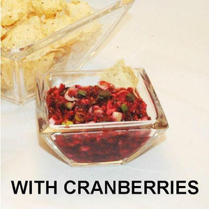 Spicy Tortuga Bay Cranberry Orange Salsa served with tortilla chips