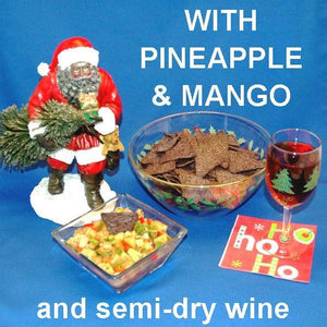 Tortuga Bay Pineapple Mango Salsa with red peppers and green onions, served with blue corn tortilla chips and semi-dry blush wine Christmas
