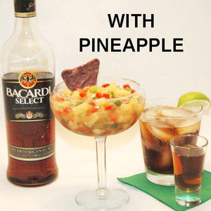 Spicy Tortuga Bay Pineapple Salsa with red peppers and green onions, served with blue corn tortilla chips and rum and coke cocktail