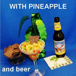 Tortuga Bay Pineapple Salsa with red peppers and green onions, served with blue corn tortilla chips and summer ale