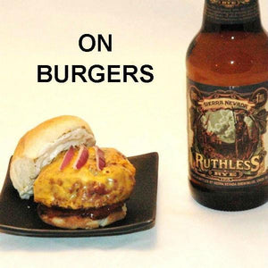 Cheeseburger slider with Tortuga Bay Spicy Ketchup, served with ale