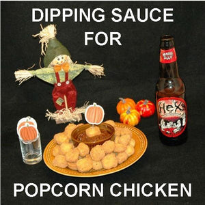 Popcorn chicken with spicy Tortuga Bay Ketchup for dipping, served with fall ale