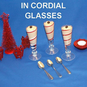 Traditional Orange Chocolate Mousse served in cordial glasses, garnished with chocolate pearls Christmas