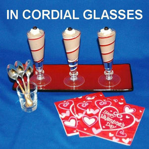 Traditional Orange Chocolate Mousse with whipped cream and chocolate pearl garnish, served in cordial glasses Valentine's