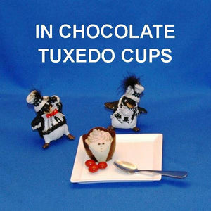 Traditional Orange Chocolate Mousse in chocolate tuxedo cup with penguins Christmas