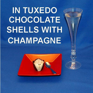 Traditional Orange Chocolate Mousse in chocolate tuxedo cup, served with champagne