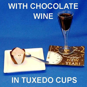 Traditional Orange Chocolate Mousse in a chocolate tuxedo cup served with chocolate wine New Year's