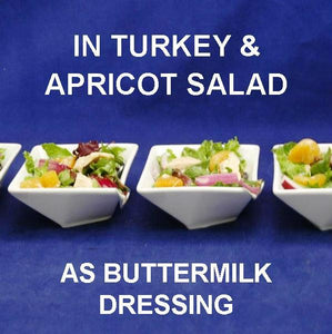 Tossed Turkey Salad with apricots, red onions and Sweet Ginger Apricot Dressing, in white tasting bowls