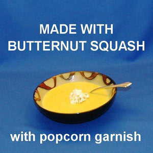 Velvety Curried Butternut Squash Bisque garnished with popcorn