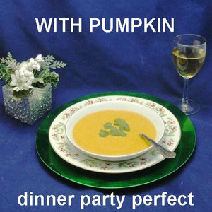 Velvety Curried Pumpkin Bisque served with white wine Christmas