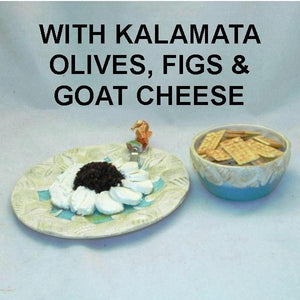 Venetian Kalamata Olive and Fig Tapenade mounded in goat chees ring, served with crackers Summer