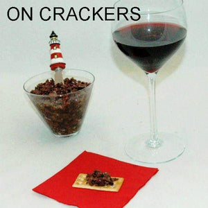 Venetian Kalamata Olive Tapenade on crackers, served with red wine