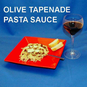 Venetian Kalamata Olive Tapenade topping pasta garnished with shaved parmesal cheese, served with red wine