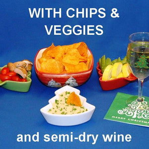 Wasabi Lemon mayonnaise and sour cream dip with chips and fresh veggie dippers, served with white wine Christmas