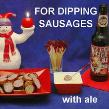 Load image into Gallery viewer, Grilled sausage slices with Wasabi Lemon Dip, served with Mad Elfl ale Christmas