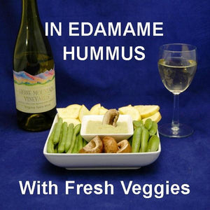 Wasabi Lemon Edamame Hummus with fresh raw sugar snap peas, yellow squash and mushrooms for dipping, served with white wine