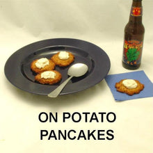 Load image into Gallery viewer, White Cheddar Horseradish Sauce topping potato pancakes, served with red wine