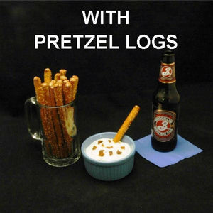 Pretzel logs with White Cheddar Horseradish Dip served with seasonal craft ale