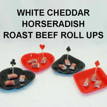 Deli roast beef roll ups with White Cheddar Horseradish Dip filling; toothpick flags and plastic plates are in shapes of card suits