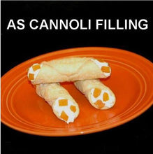 Load image into Gallery viewer, Cannoli filled with White Chocolate Amaretto Mousse, garnished with apricot pieces