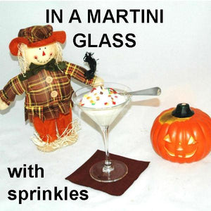 White Chocolate Amaretto Mousse in martini glass, garnished with multi colored sprinkles Fall