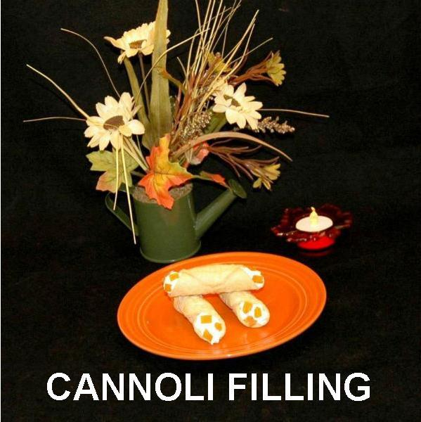 Cannoli filled with White Chocolate Amaretto Mousse, garnished with apricot pieces Fall