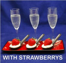 Load image into Gallery viewer, Strawberries nestled in a bed of White Chocolate Amaretto Mousse in black tasting spoons, served with champagne