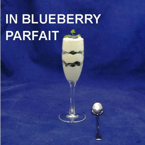 White Chocolate Amaretto Mousse and blueberry parfait, served in a flute champagne glass