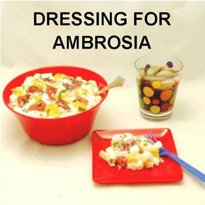Ambrosia with Mandarin orange slices, strawberries, coconut, marshmallows and White Chocolate Banana Sour Cream Dressing Summer