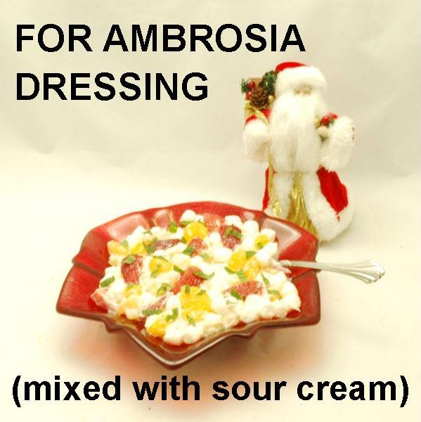 Ambrosia with Mandarin orange slices, strawberries, coconut, marshmallows and White Chocolate Banana Sour Cream Dressing Christmas