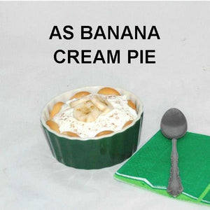 White Chocolate Banana Cream Pie with vanilla wafer crust in individual ramekin, garnished with banana slices and cinnamon