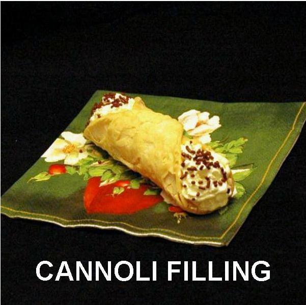 Cannoli filled with White Chocolate Banana Mousse, garnished with chocolate sprinkles Summer