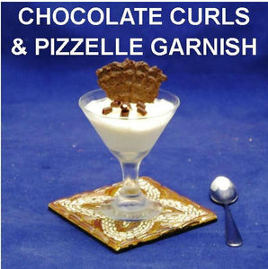 White Chocolate Banana Mousse in mini martini glass garnished with chocolate curls and pizzelle cookie piece