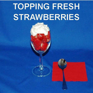 Fresh strawberries topped with White Chocolate Banana Mousse, in a wine glass