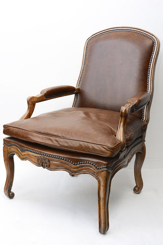 A Pair of French Leather Upholstered Walnut Framed Fauteuils