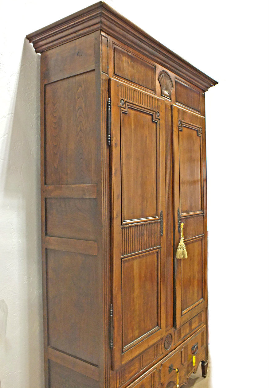 A French Fruitwood Straight Fronted Armoire