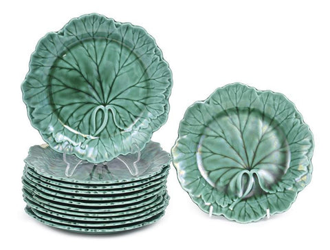 A Collection of Twelve Wedgwood Green Majolica Glazed Plates
