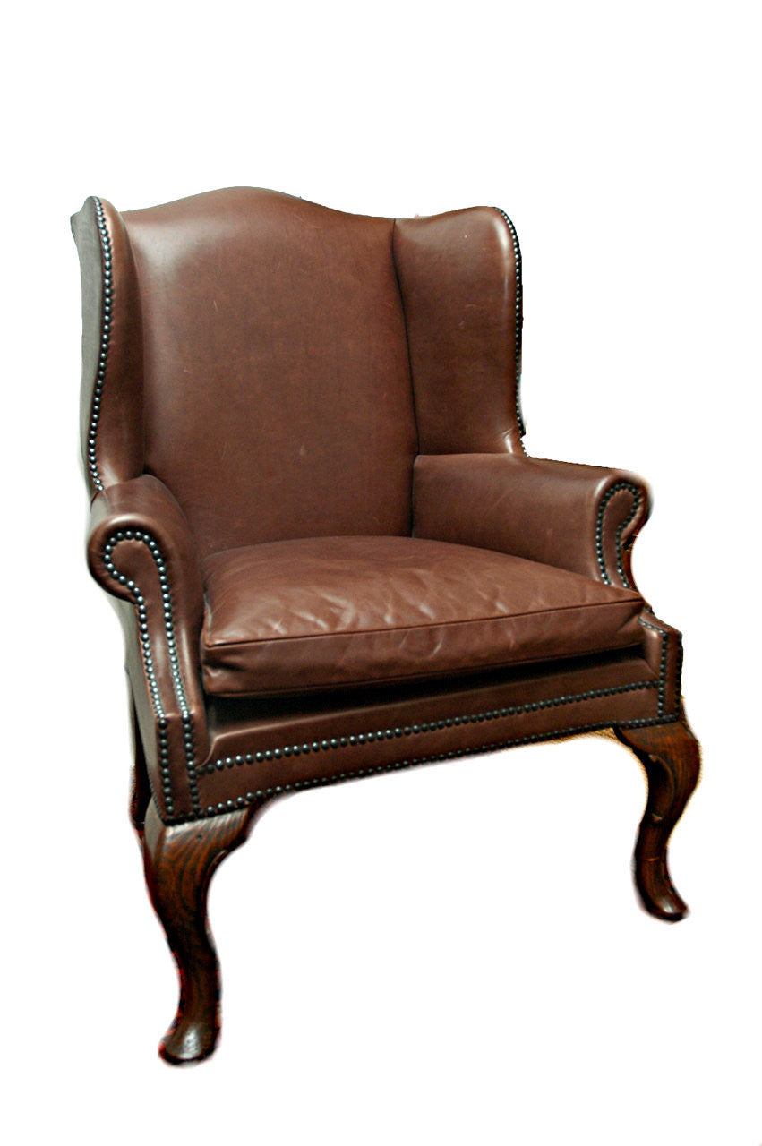 A Leather Winged Back Armchair