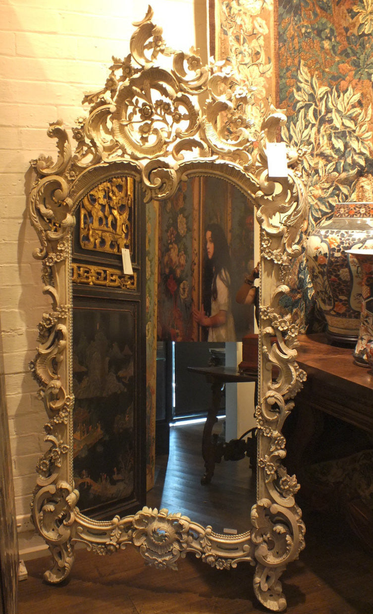 An Ornate Leaf Scroll Carved Louis XV Style Giltwood Mirror