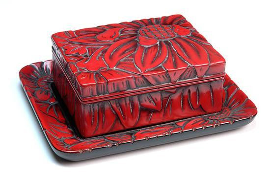 A Japanese Red Lacquered Lidded Box and Tray