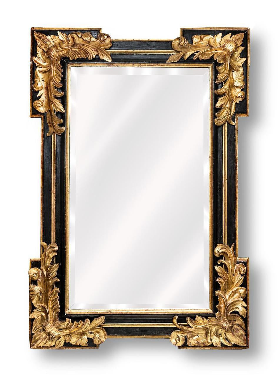 An Early 18th Century Spanish Ebonized & Gilded Mirror.