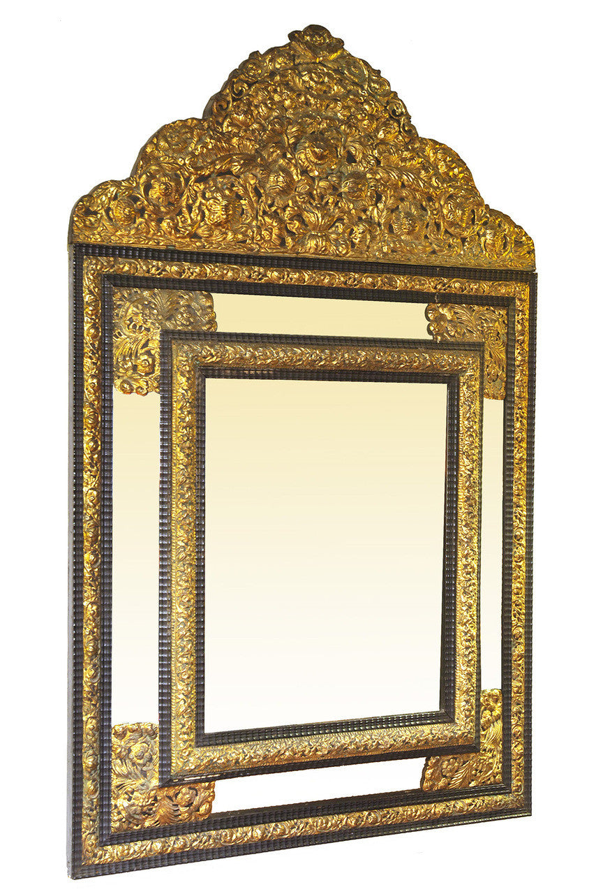 A French Embossed Brass Mounted Cushion Front Mirror.