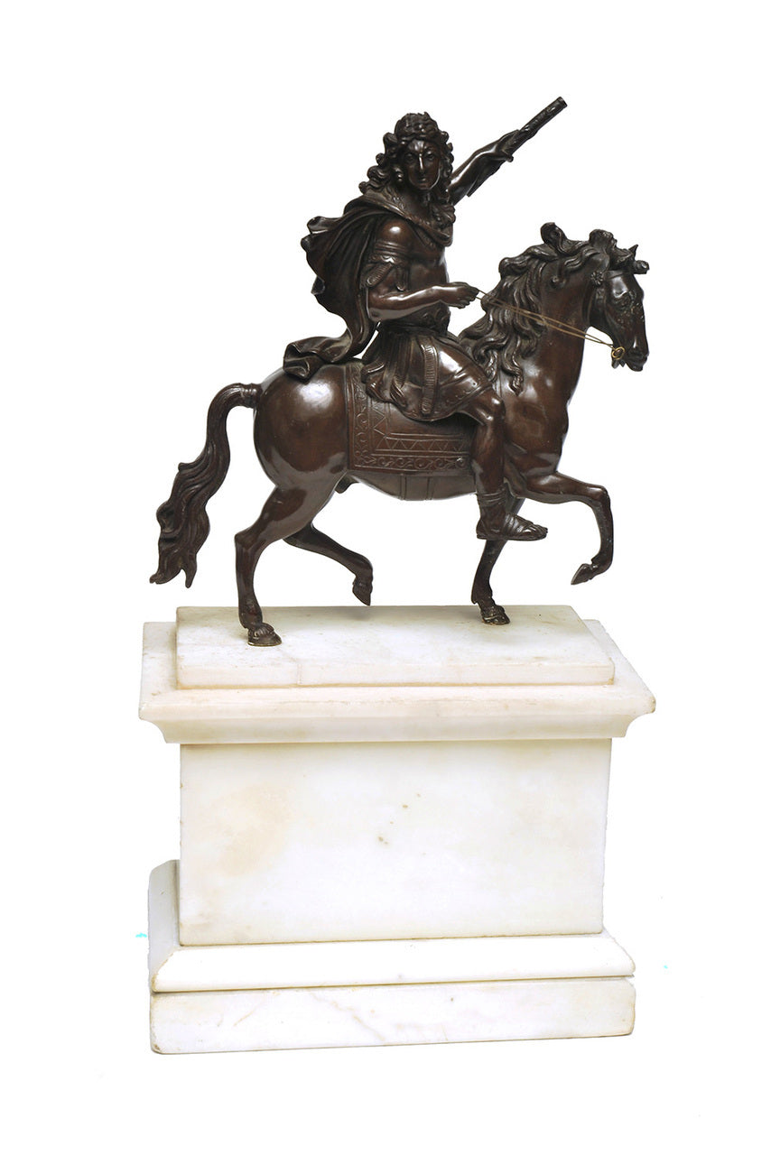 A Bronze Figure of a Cavalryman, On a Marble Base.
