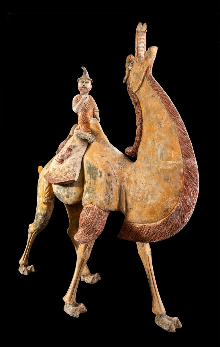 A Pair of Tang Dynasty Chinese Terracotta Bactrian Camels with Riders