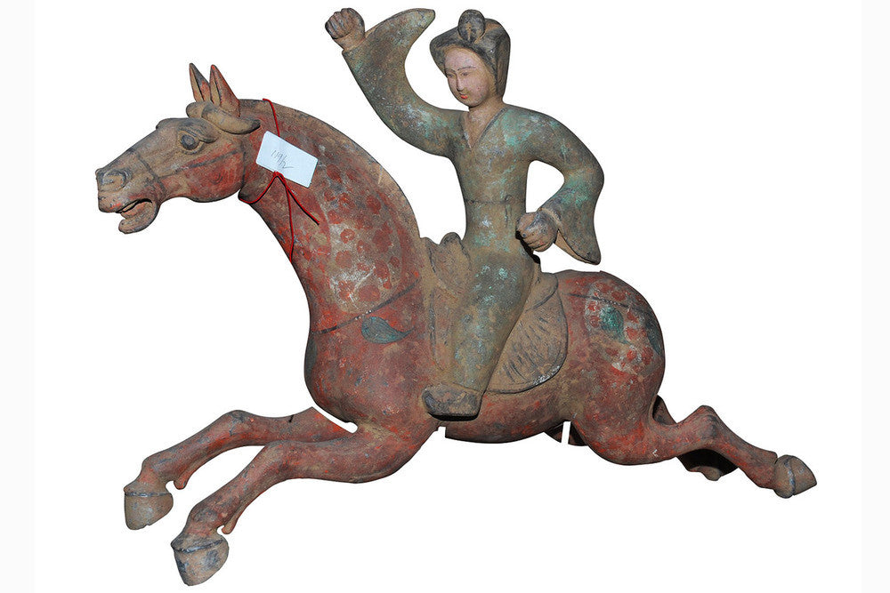 A Chinese Pottery Equestrian Model of a Polo Player, Tang Dynasty