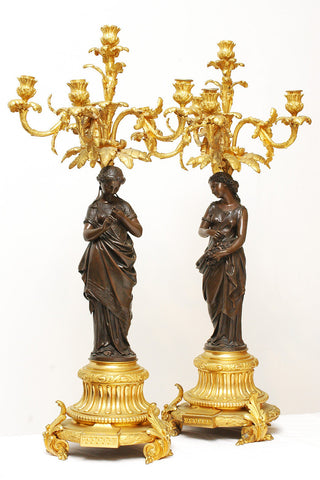 A Pair of French Bronze and Gilt Candelabras