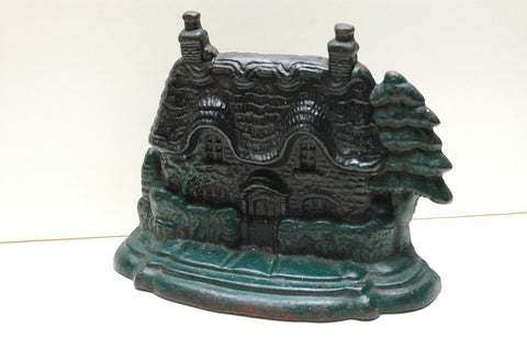 A Cast Iron Gingerbread House Door Stopper